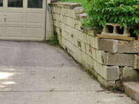 a failing retaining wall around a driveway in Calgary