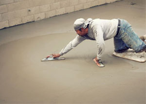 smoothing out the grout in a slab releveling project in Cochrane