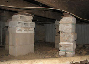 crawl space repairs done with concrete cinder blocks and wood shims in a Rocky Mountain House home