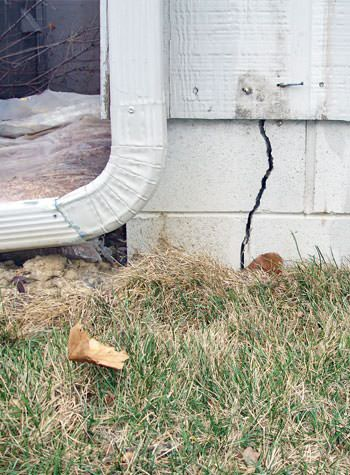 foundation wall cracks due to street creep in Esther