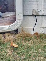 Garage slab pushed rearward creating gaps