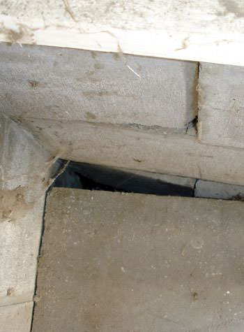 inward rotation of a foundation wall damaged by street creep in a garage in Sunnynook