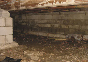 Rotting, decaying crawl space wood damaged over time in Scapa