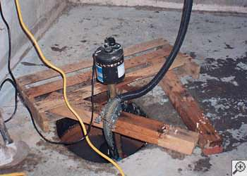 A Didsbury sump pump system that failed and lead to a basement flood.