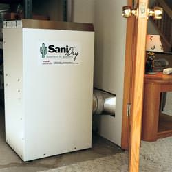 A basement dehumidifier with an ENERGY STAR® rating ducting dry air into a finished area of the basement  in Torrington