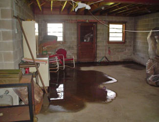 a flooded basement floor in a Torrington home