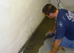 Restoring a concrete slab floor with fresh concrete after jackhammering it and installing a drain system in Scapa.