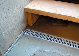 a hatchway entrance in Didsbury that has been protected from flooding by our TrenchDrain basement drainage system.