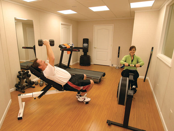 ... A Basement Gym And Workout Room With A Wood Laminate Flooring,  Installed In Airdrie, ...